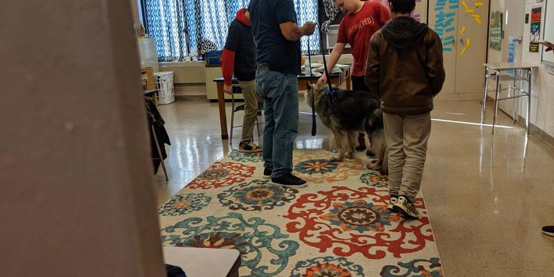 kids gather around dog for SPCA
