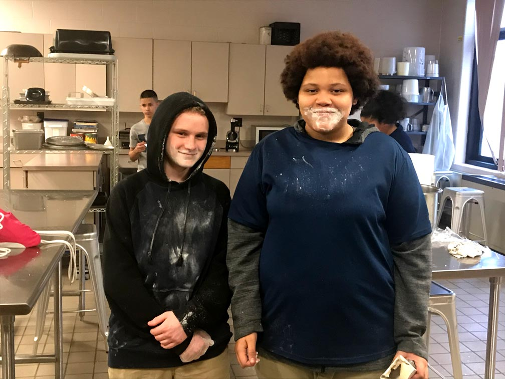 culinary students covered in flour