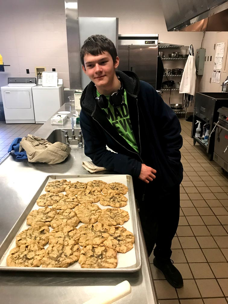 Student poses with fresh baked goods